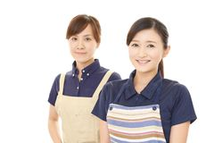Smiling women in apron. Portrait of Asian women in apron royalty free stock image