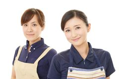 Smiling women in apron. Portrait of Asian women in apron stock image