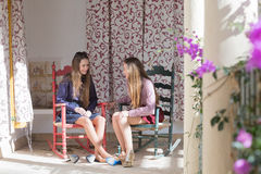 Smiling women on balcony with shoes off Royalty Free Stock Photos