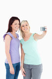Smiling women with a camera Royalty Free Stock Photo
