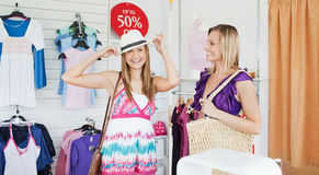Smiling women choosing clothes together Royalty Free Stock Photo