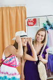 Smiling women choosing clothes together Stock Photo