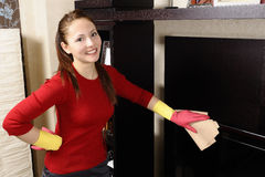 Smiling women cleaning the house Stock Image