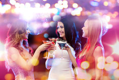 Smiling women with cocktails at night club Stock Image