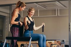 Smiling women doing pilates workout at the gym Stock Image