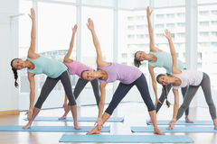 Smiling women doing stretching exercises in fitness studio Royalty Free Stock Photo