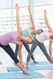 Smiling women doing stretching exercises Stock Image