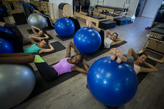 Smiling women exercising with fitness ball Stock Image