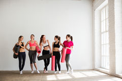 Smiling women in fitness studio. Royalty Free Stock Image