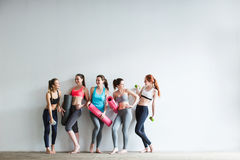Smiling women in fitness studio. Stock Photography