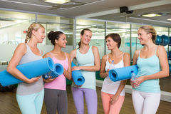 Smiling women in fitness studio before yoga class. At the leisure center Royalty Free Stock Image