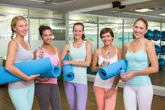 Smiling women in fitness studio before yoga class Stock Photo