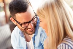 Nice moment with a loved men. Smiling women having nice moment with a loved men in restaurant, relationship and emotion stock photo
