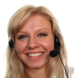 Smiling women on a headset. Beautiful smiling women on a headset 1 Royalty Free Stock Photography