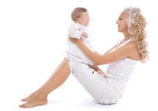 Smiling women with her little child Royalty Free Stock Photography