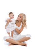 Smiling women with her little child Royalty Free Stock Photo