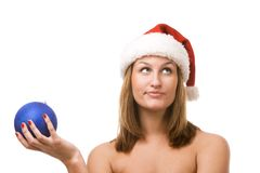 Smiling women holding christmas toy. Smiling women in Santa's hat holding christmas toy Stock Photos
