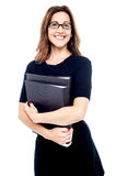 Smiling women holding folder in hand Royalty Free Stock Images