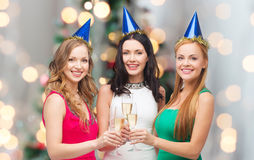 Smiling women holding glasses of sparkling wine Stock Photos