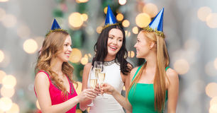 Smiling women holding glasses of sparkling wine Royalty Free Stock Photos