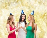 Smiling women holding glasses of sparkling wine Stock Image