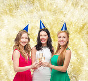 Smiling women holding glasses of sparkling wine Stock Photo