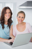 Smiling women with laptop Royalty Free Stock Image