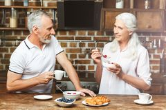 Woman looking at her husband drinking coffee royalty free stock images