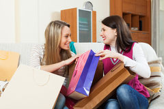 Smiling women looking shopping bags Stock Images