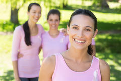 Smiling women in pink for breast cancer awareness. On a sunny day royalty free stock photos