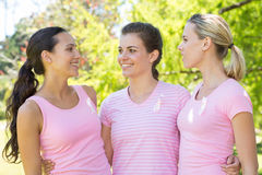 Smiling women in pink for breast cancer awareness Stock Image