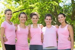 Smiling women in pink for breast cancer awareness Royalty Free Stock Image