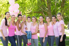 Smiling women in pink for breast cancer awareness Stock Photography