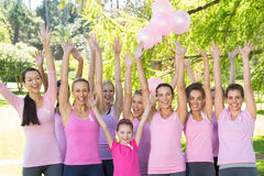 Smiling women in pink for breast cancer awareness Royalty Free Stock Images