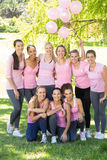 Smiling women in pink for breast cancer awareness Stock Images