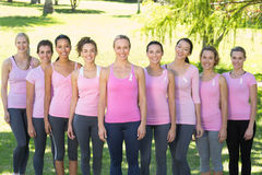Smiling women in pink for breast cancer awareness Stock Photo