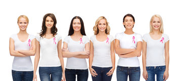 Smiling women with pink cancer awareness ribbons Royalty Free Stock Photo