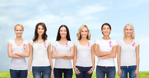 Smiling women with pink cancer awareness ribbons Stock Photography
