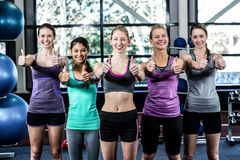 Smiling women posing together with thumbs up Royalty Free Stock Photo