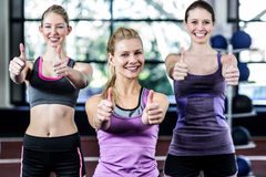 Smiling women posing together with thumbs up Stock Photography