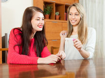 Smiling women with pregnancy test Stock Image