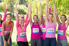Smiling women running for breast cancer awareness Stock Photography