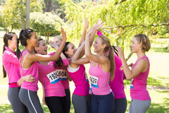 Smiling women running for breast cancer awareness Stock Photo