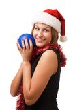 Smiling women in Santa's hat. Smiling women holding christmas toy Royalty Free Stock Photos