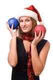 Smiling women in Santa's hat. Smiling women holding christmas toy Stock Image
