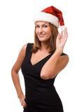 Smiling women in Santa's hat Stock Photography
