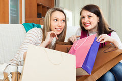Smiling women  with shopping bags Royalty Free Stock Image