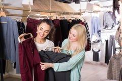 Smiling women shopping pants Royalty Free Stock Image