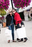 Smiling women shopping with white bags stock image