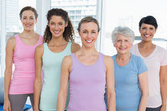 Smiling women standing in yoga class Royalty Free Stock Photos